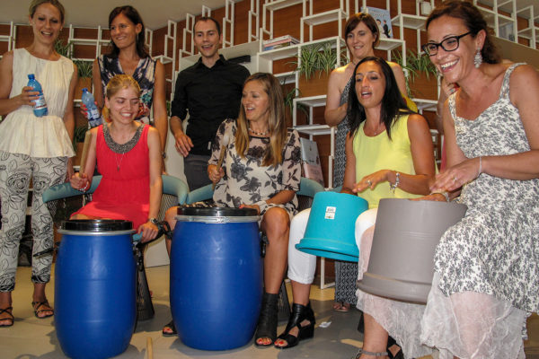team building drum stomp music junk percussion recycled materials experiential training